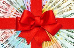 Geld mit roter Schleife