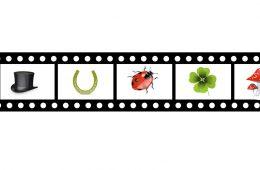 Filmrolle mit Glückssymbolen