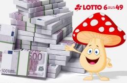 Glückspilz freut sich über Geldhaufen
