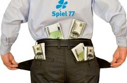 Geschäftsmann steckt sich Geld in die Tasche