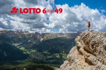 Frau auf Berg mit Aussicht Lotto