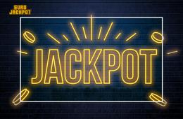 Lotterie, neonaler Hintergrund. Jackpot in Neonschrift geschrieben auf einer Backsteinwand.
